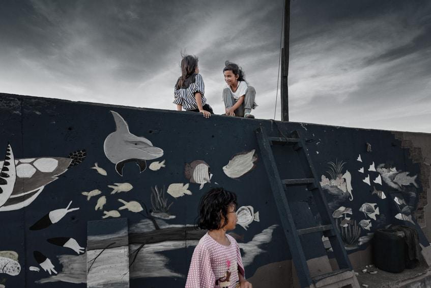 children on wall