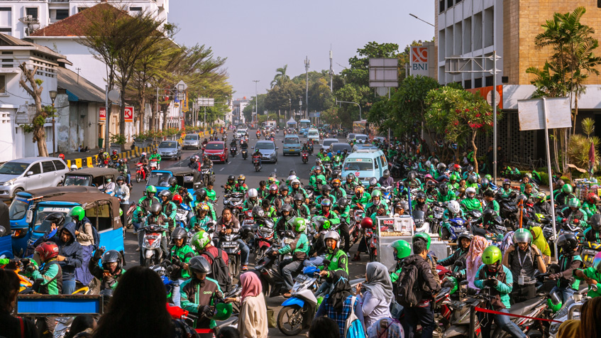 Ojek drivers in front of station