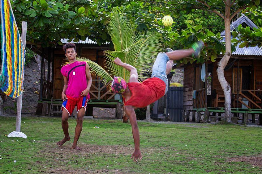 Playing sepak takraw