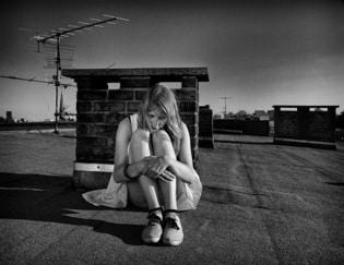 sad on the roof