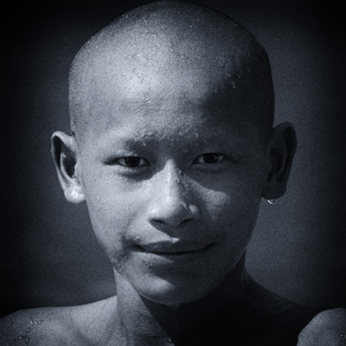 young monk bald Laos